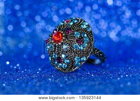 Jewellery ring against blue background