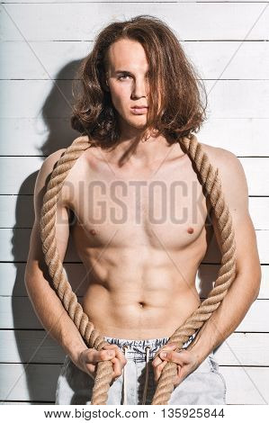 Sexy Caucasian Man Model Shirtless With Rope On White Background
