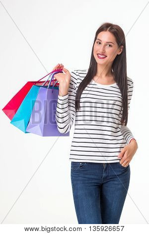 Happy shopping. Young woman holding multicolored shopping bags