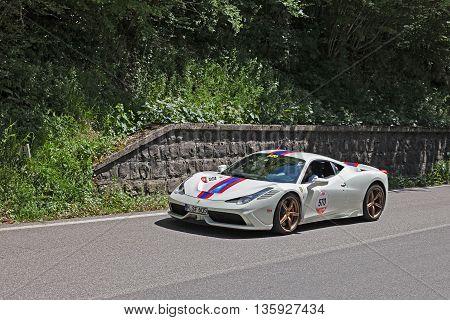 PASSO DELLA FUTA (FI) ITALY - MAY 21: crew on a supercar Ferrari 458 Speciale in rally