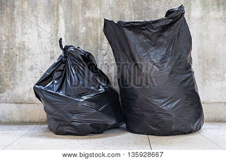 Close-up Of A Full Garbage Bags On Floor