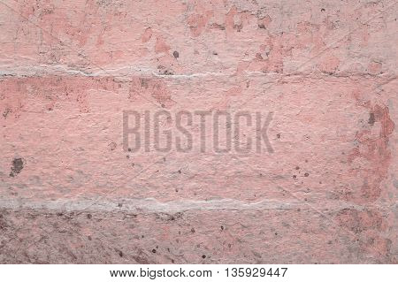 Grunge wall of the old house. Textured background. Plaster hue Rose Quartz