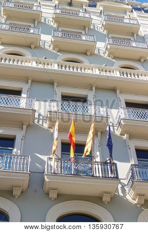 spanish catalan and european flags on exterior of an modernist building from barcelona