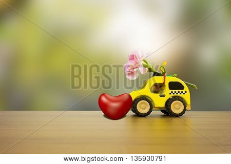 beautiful and colorful flower carnations in wooden car on the Wooden Table.