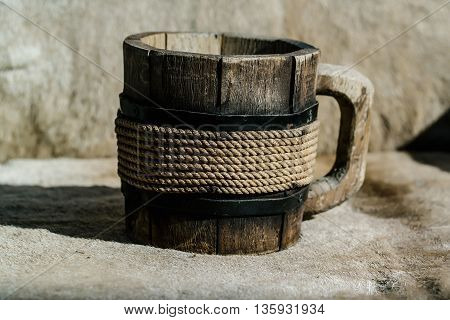 Close up of wooden mug with thread decor for a nice drink