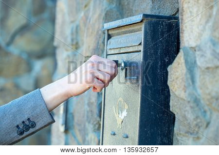 Female Hand Opens Post Box