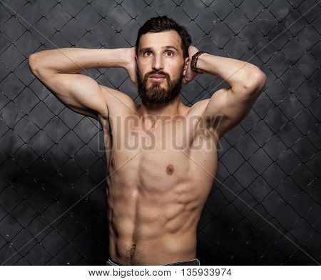 Shirtless muscular sexy guy with beard showing his great body