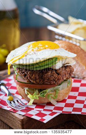Vegetarian burger made with rice and beans with egg and avocado