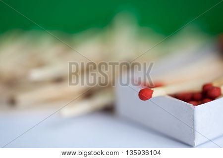 A wooden matches in the box with partial focus