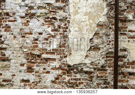 Old red brick wall with sprinkled white plaster texture background from oldtown