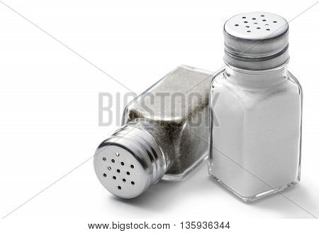 Salt and pepper shakers on a white background