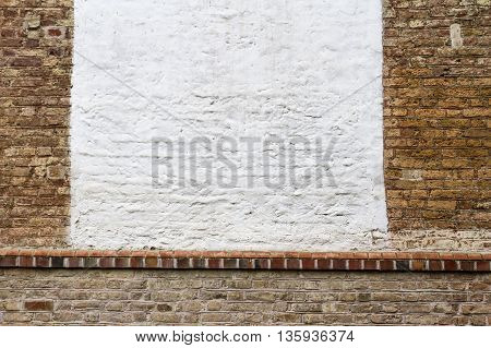 Old red grunge brick wall with empty place for text or image background texture.