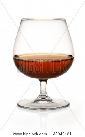 Close up Glass of brandy on white background