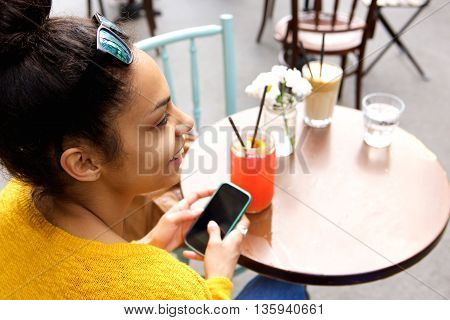 Young Woman Sitting At Coffeeshop