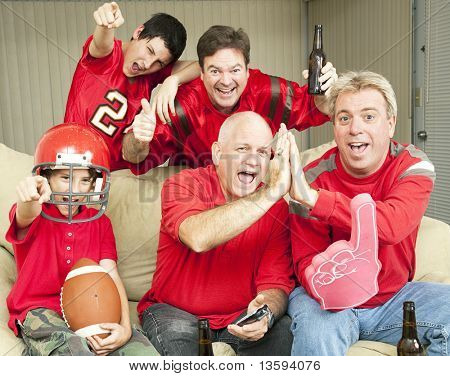 American football fans get together for a super bowl party.