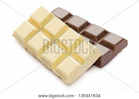 Broken milk and white chocolate bars close up
