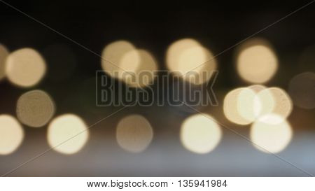 Background Bokeh warm white color blur on black background are circle shape lighting.