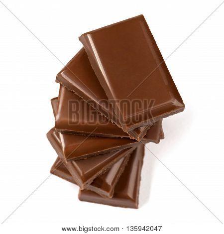 Stack of broken milk chocolate bars close up