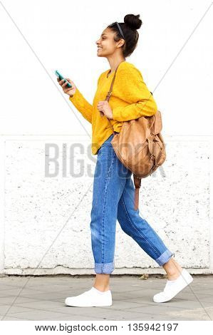 Stylish Young Woman Walking With Bag And Mobile Phone