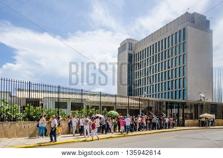 HAVANA - CUBA JUNE 20, 2016: People line up outside the Embassy of the United States of America for consular services. The embassy was reopened when the United States and Cuba renewed diplomatic relations on July 20, 2015.