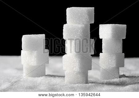 Pile of sugar cubes on black and white background