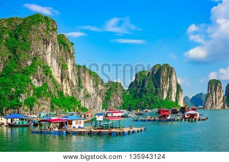 Floating fishing village and rock islands in Halong Bay Vietnam Southeast Asia. UNESCO World Heritage Site.