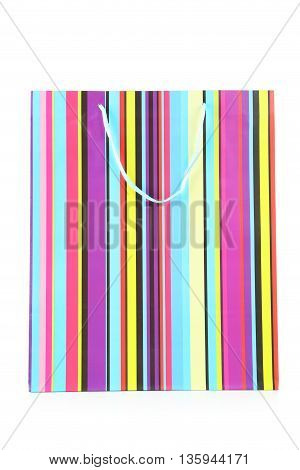Colourful paper shopping bag isolated on white