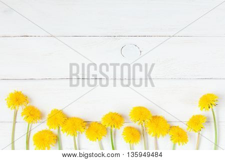 Dandelions On Wooden White Background Flat Lay