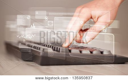 Hand touching keyboard with high tech button screen