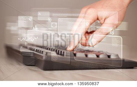 Hand touching keyboard with high tech button screen