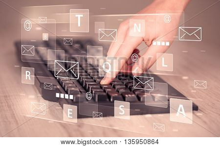 Hand typing on keyboard with digital tech icons and symbols