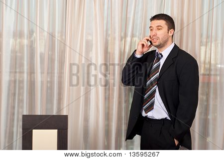Business Man With Phone Mobile In Office