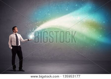 Caucasian businessman holding aurora borealis kind of stria of light