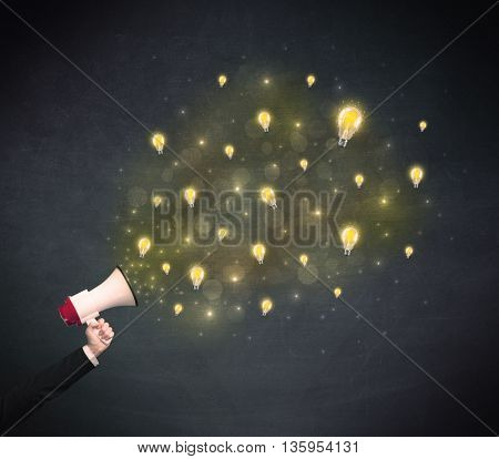 Caucasian business hand holding megaphone with yellow lightbulbs