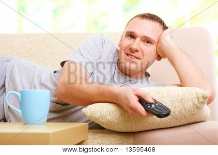Smiling Man Watching Television