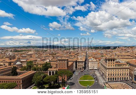 Aerial panoramic view of central Rome from the Vittoriano Monument with Piazza Venezia and Palazzo Venezia in foreground
