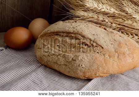 buckwheat bread on a wooden table. Vintage Country Still Life