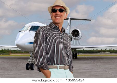 Fashionable man with a private jet in the background