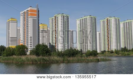 St.Petersburg Russia may 29 2016 Modern highrise buildings standing over lake under blue sky