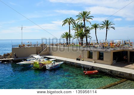 MALLORCA SPAIN - MAY 29: The tourists enjoiying their vacation on the beach on May 29 2015 in Mallorca Spain. Up to 60 mln tourists is expected to visit Spain in year 2015.