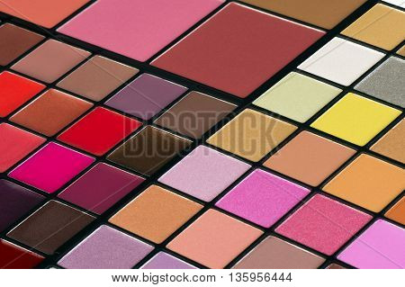 Colorful make up palette with lipsticks and eye shadows.