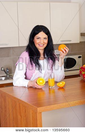 Happy Woman With Fresh Orange Juice