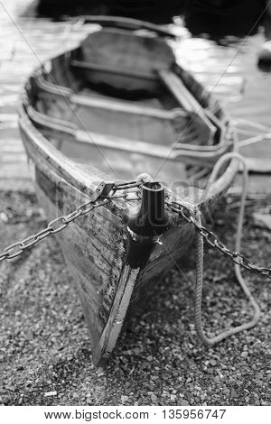 Black and white image of a wooden rowing boat