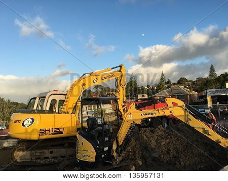 AUCKLAND JUN. 24: Mechanical digger excavator in operation at project construction work site in Auckland New Zealand taken on June 24 2016.