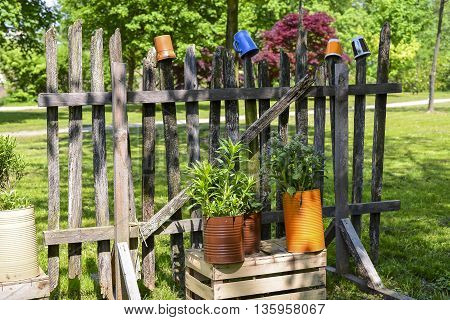 A rural wooden fence with colorful decoration