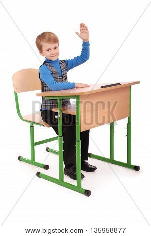 Boy raising hand to ask question isolated on white