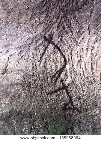 Art In Sandstone Cave. Black Carbon Paint Of Human Hunting