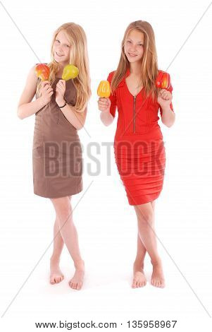 Young girl holds near the face apples and pears isolated on white