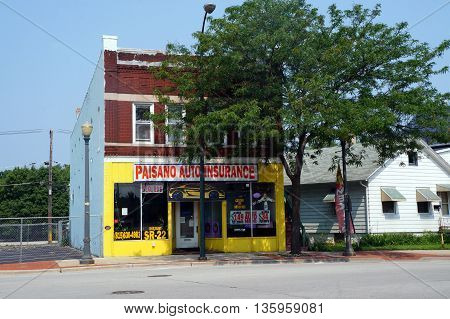 JOLIET, ILLINOIS / UNITED STATES - JUNE 30, 2015: One may purchase auto insurance at Paisano Auto Insurance in downtown Joliet.