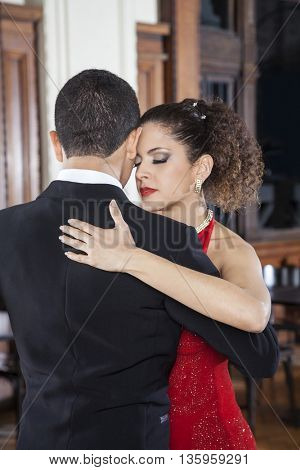 Woman And Partner Touching Foreheads While Performing Tango